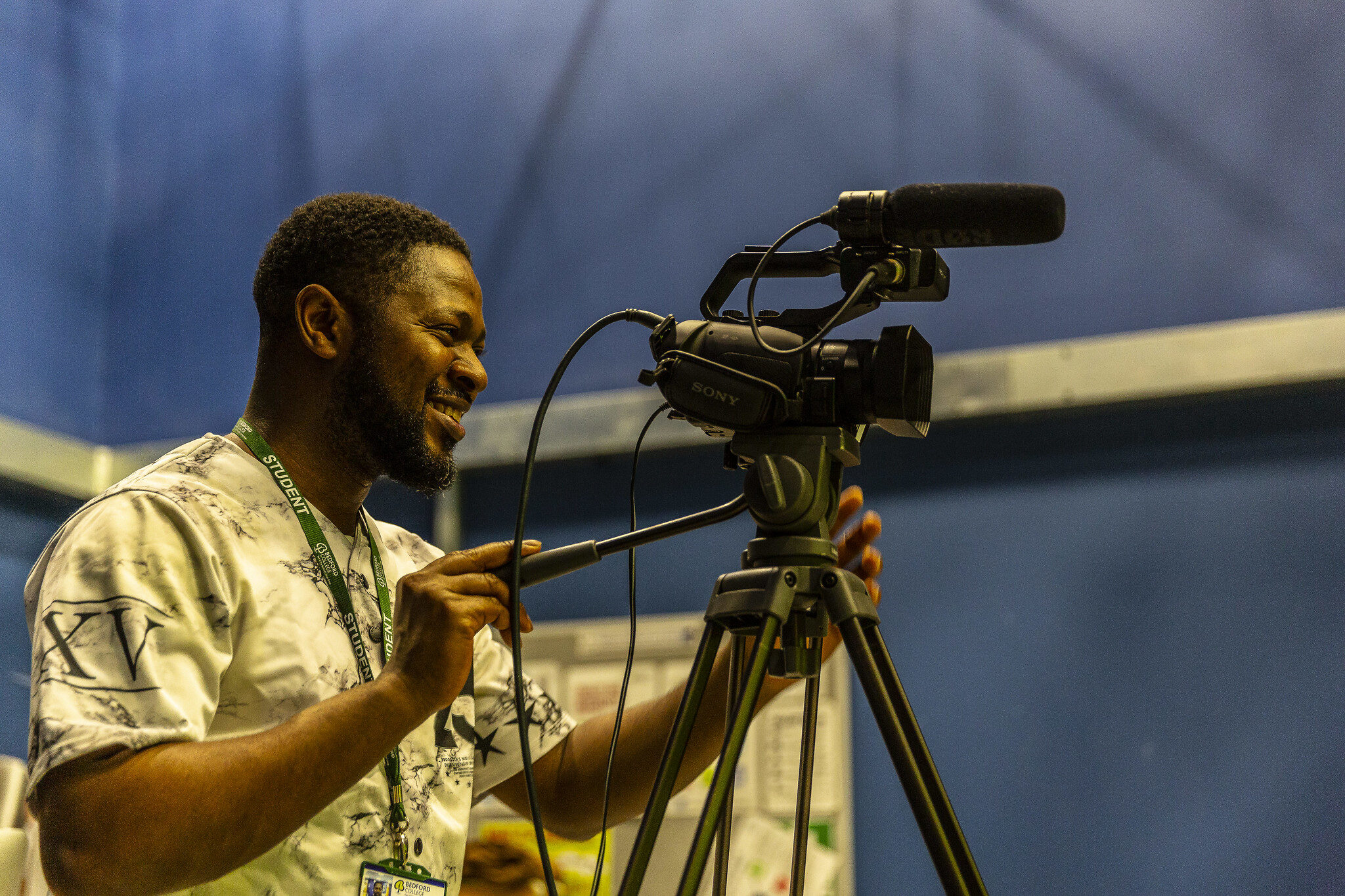Media student with camera filming Bedford College