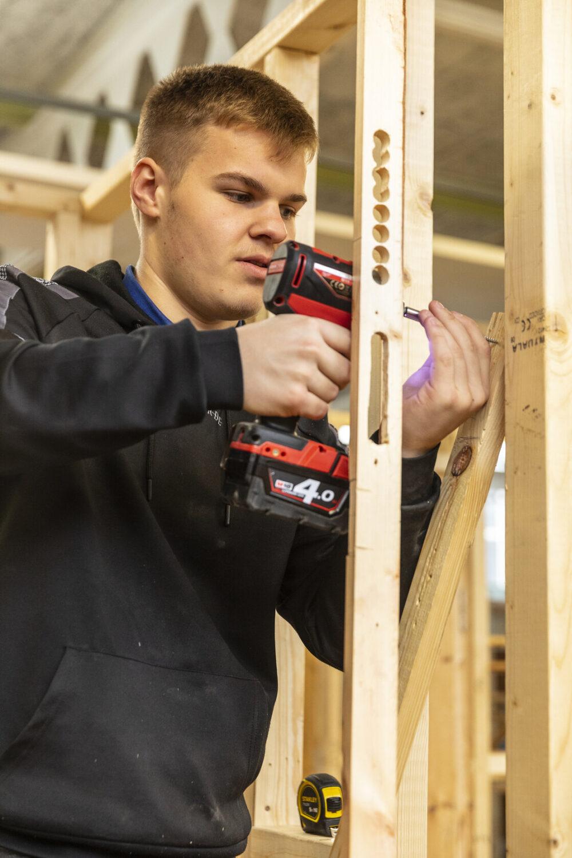 Construction student using drill Tresham College