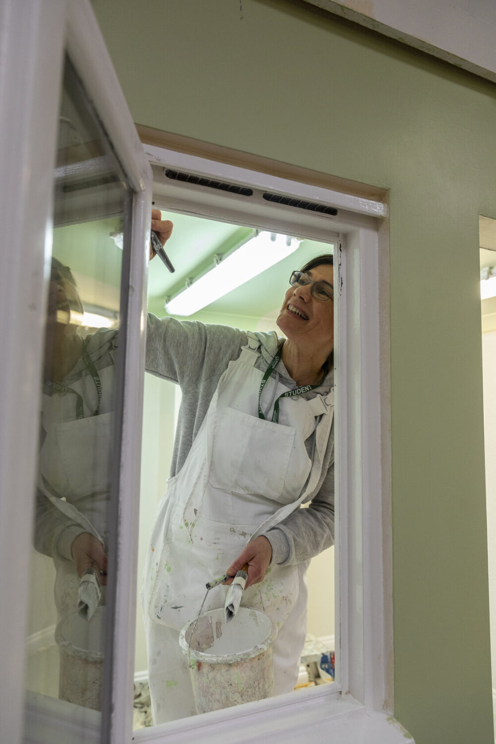 Female painting and Decorating Bedford College student
