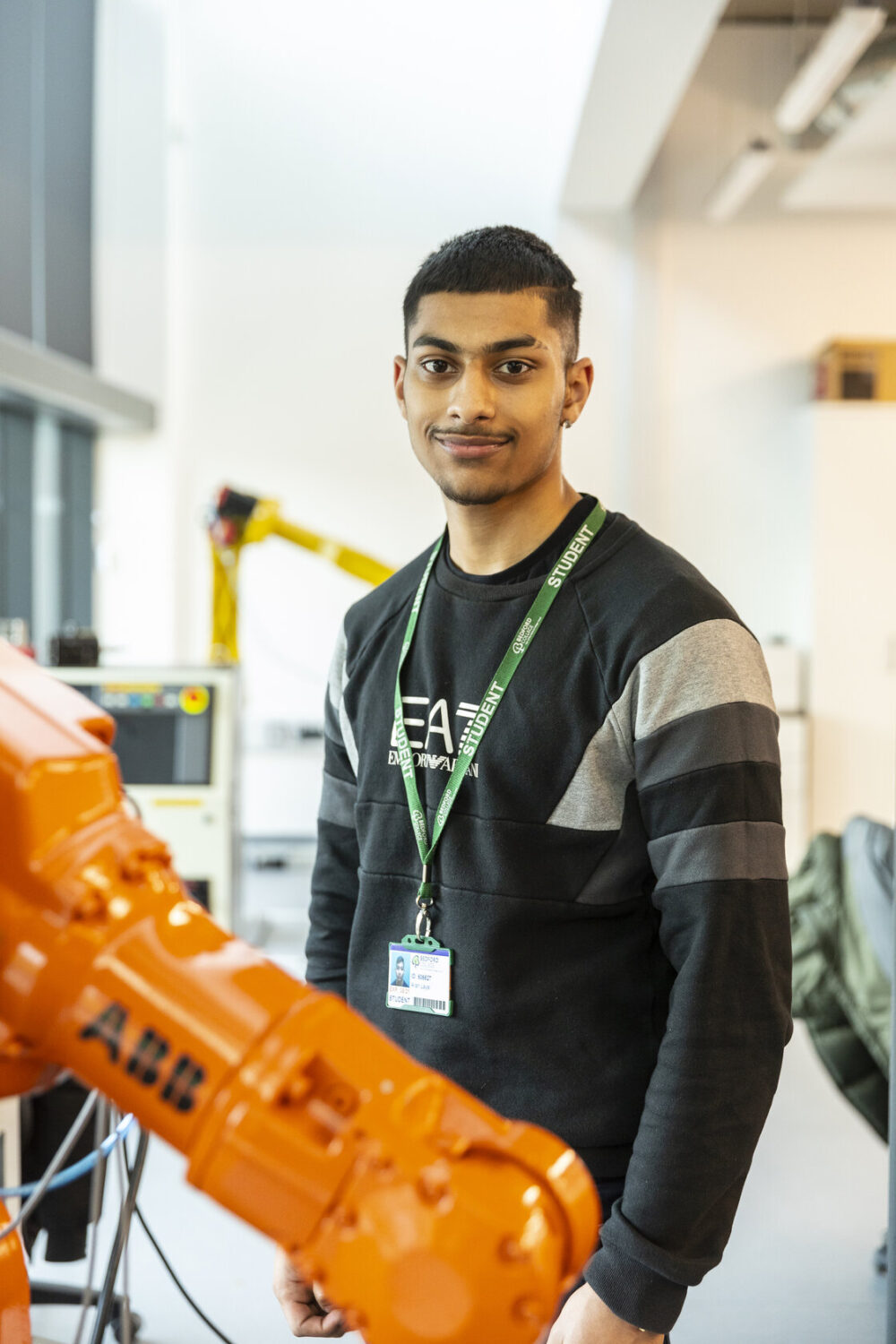 Engineering student with robotic arm Bedford College