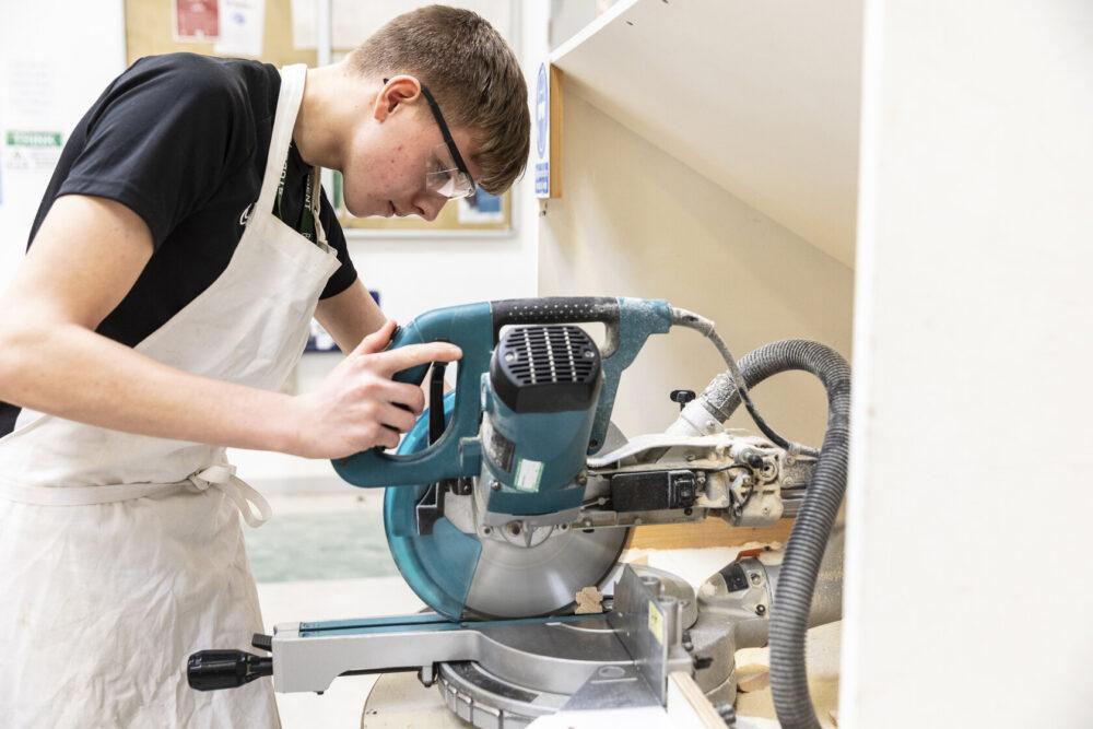 Construction student using machinery Tresham College
