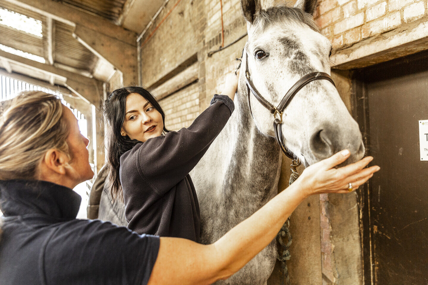 Equine student and tutor with horse Shuttleworth College