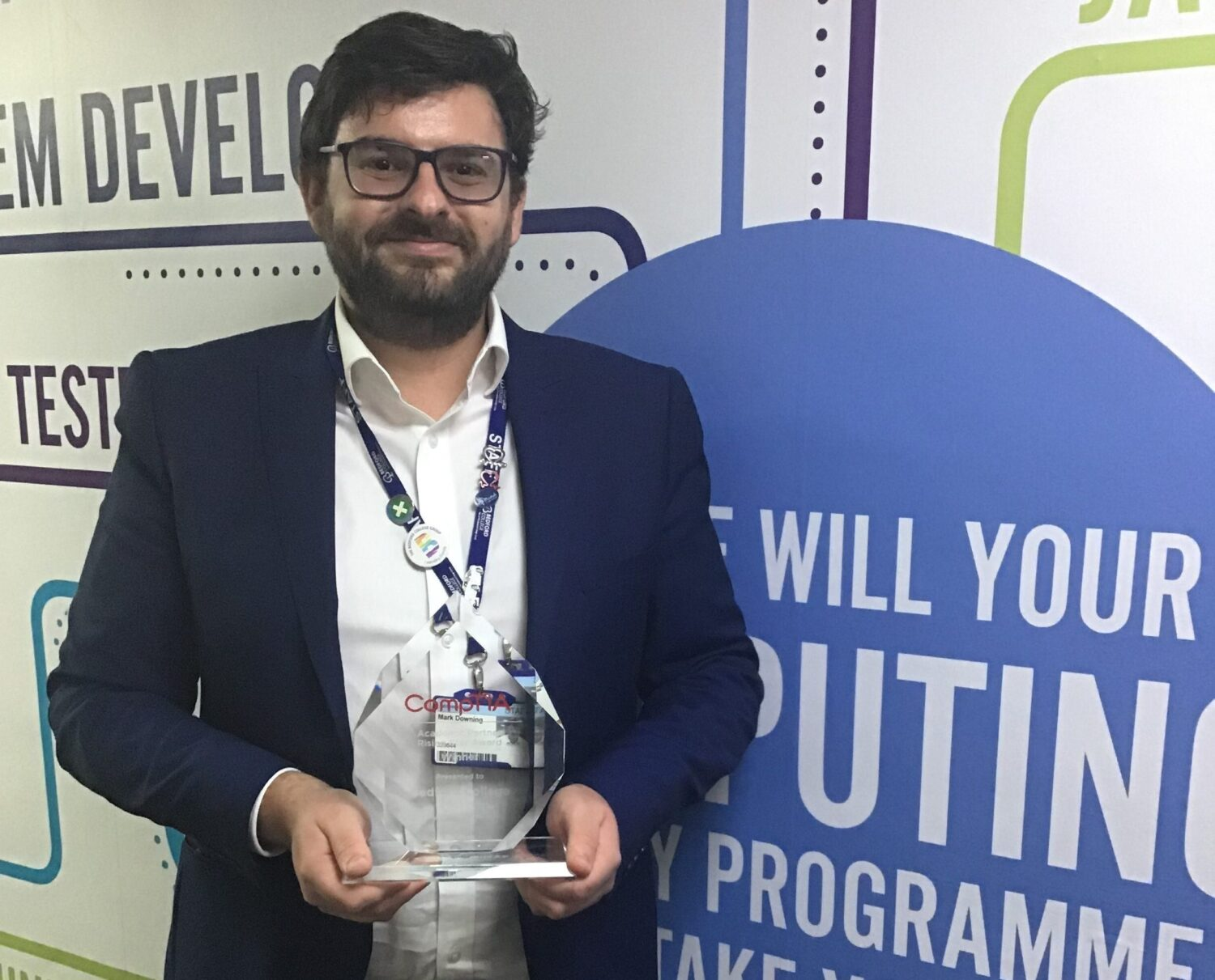 Bedford College Computing tutor Mark Downing with award